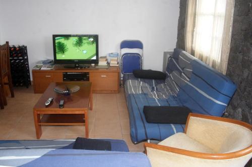 A television and/or entertainment center at Retiro dos Cabritos