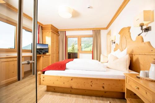 A bed or beds in a room at Bergwald