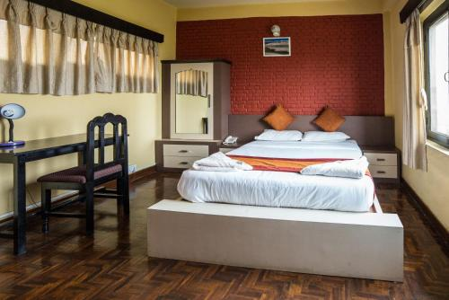 A bed or beds in a room at Planet Bhaktapur Hotel