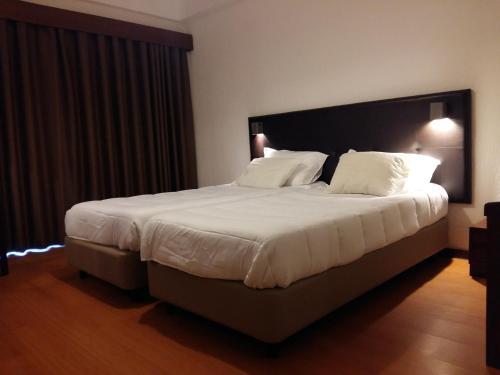 Cama o camas de una habitación en Riabela Inn