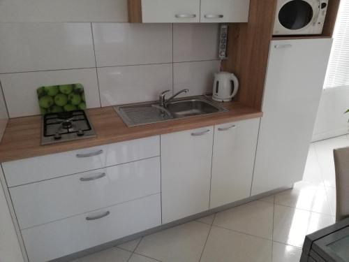 Kuchyň nebo kuchyňský kout v ubytování Vita Style