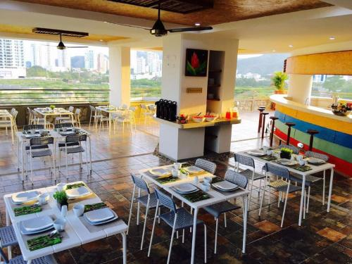 A restaurant or other place to eat at XL Penthouse 150m2 en Terrazas Tayrona 8-10 pax