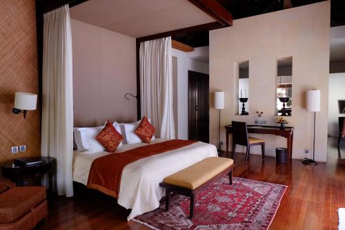 A bed or beds in a room at The Royal Santrian