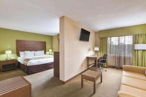 A television and/or entertainment center at La Quinta Inn by Wyndham Austin North