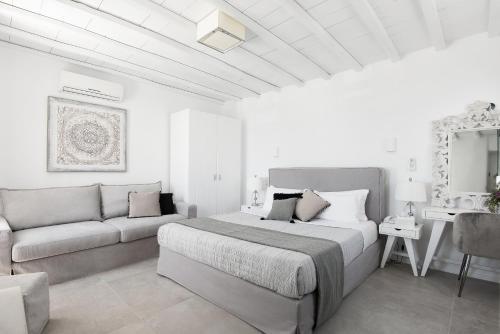 Ένα ή περισσότερα κρεβάτια σε δωμάτιο στο Riva Suites