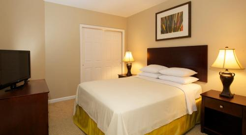 A bed or beds in a room at WorldQuest Orlando Resort