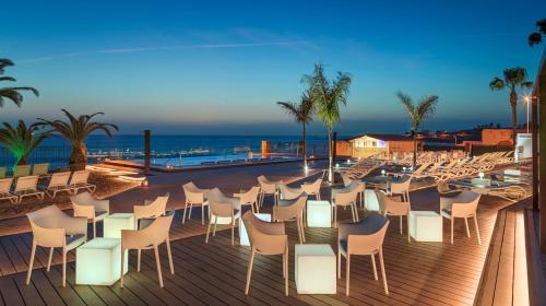 Un restaurante o sitio para comer en H10 Costa Adeje Palace