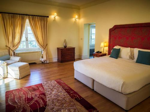 A bed or beds in a room at Hotel Villa Casanova