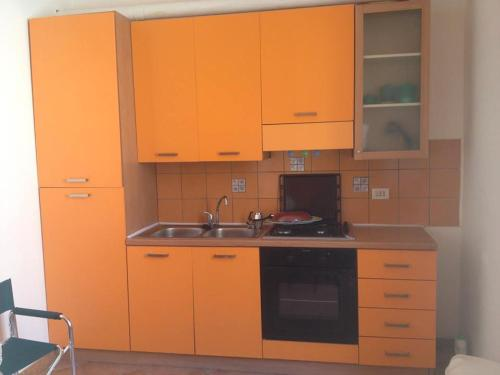 A kitchen or kitchenette at lampedusa mareblu sei