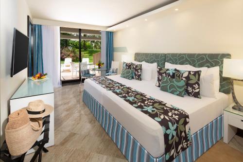 Cama o camas de una habitación en Grand Oasis Cancun - All Inclusive