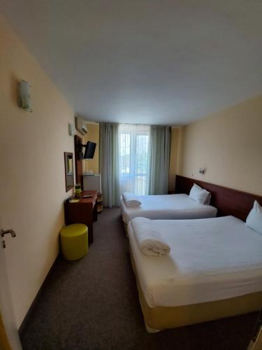 Ein Bett oder Betten in einem Zimmer der Unterkunft Hotel Galant