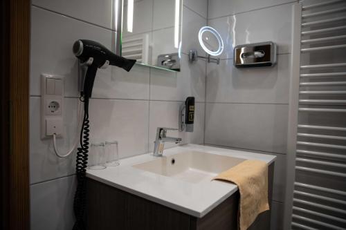 Ein Badezimmer in der Unterkunft Landgasthof Goldener Pflug