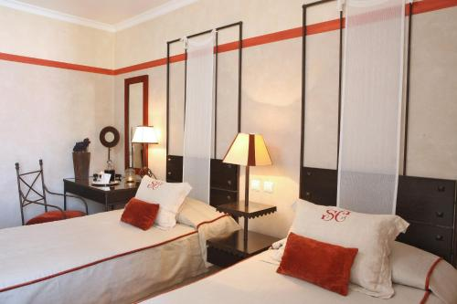 A bed or beds in a room at Solar do Castelo - Lisbon Heritage Collection - Alfama