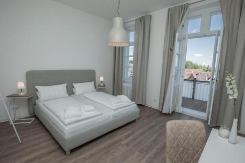 A bed or beds in a room at Boardinghouse Flensburg - by Zimmer FREI! Holidays