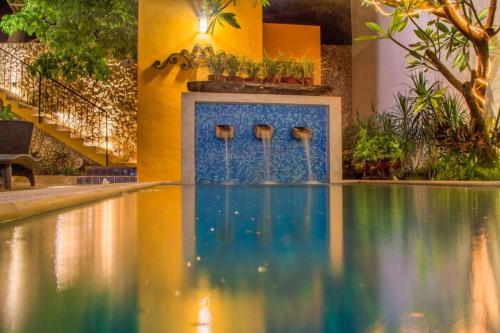 The swimming pool at or near Hotel Boutique Casa Flor de Mayo