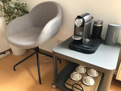 Coffee and tea making facilities at City Apartment Bielefeld
