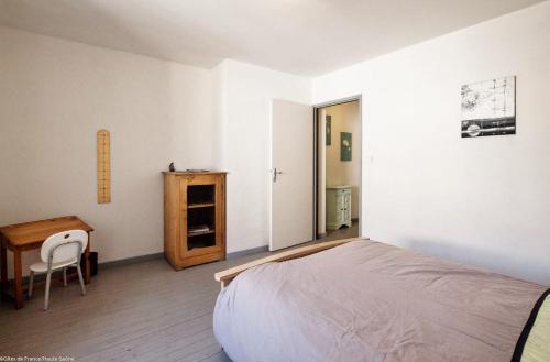 Un ou plusieurs lits dans un hébergement de l'établissement Gîte La Saônoise