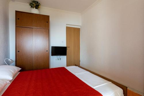 A bed or beds in a room at Apartments Belenum