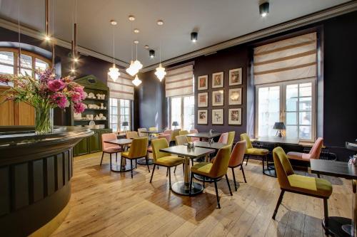 Ein Restaurant oder anderes Speiselokal in der Unterkunft Boutique Hotel KRISTOFS