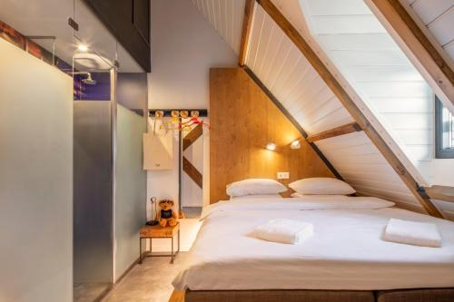A bed or beds in a room at BUNK Hotel Utrecht