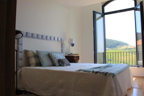 Uma cama ou camas num quarto em Quinta de Fiães