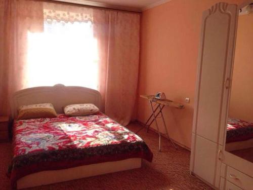 Cama ou camas em um quarto em Хорошая Квартира в Центре 1