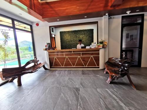The lobby or reception area at Charms Hotel