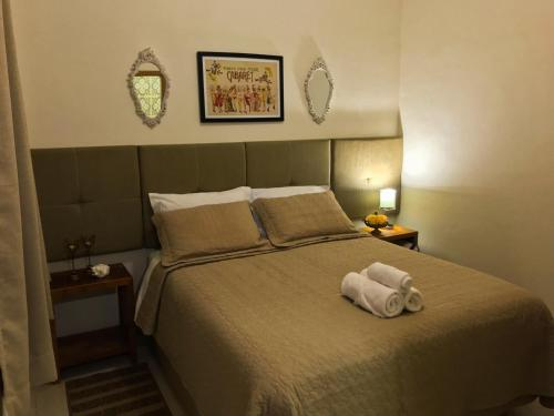 A bed or beds in a room at Pousada Divina Minas