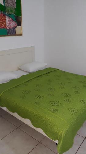 A bed or beds in a room at Pension Giulia
