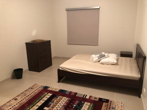 Cama ou camas em um quarto em Alwaha apartment 2 bedrooms