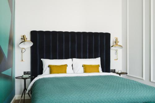 A bed or beds in a room at No.4 Residence