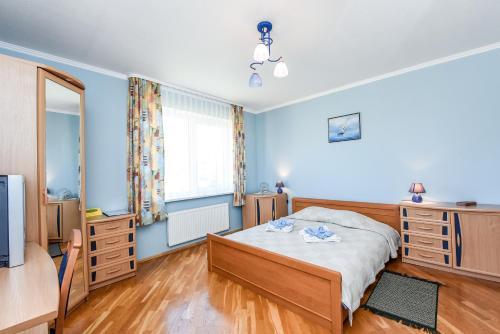 A bed or beds in a room at Viesu Nams Mazais