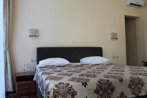 Кровать или кровати в номере Гостиница Седьмое Небо