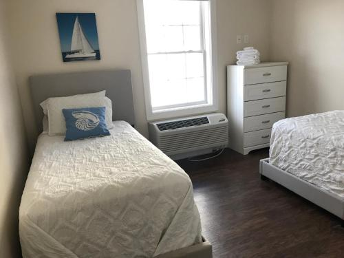 A bed or beds in a room at Atlantic Ocean Suites