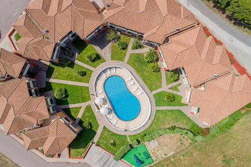 A view of the pool at Residenza Le Farfalle or nearby