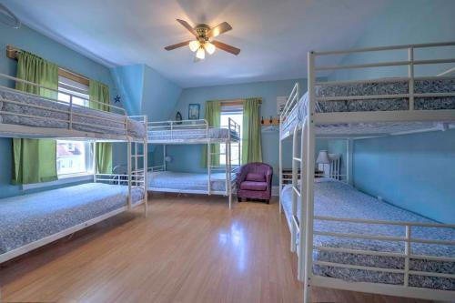 A bunk bed or bunk beds in a room at HI Charlottetown Backpacker's Inn