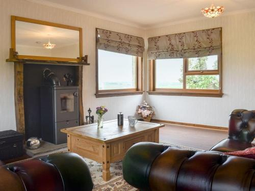 A seating area at The Palace Cottage