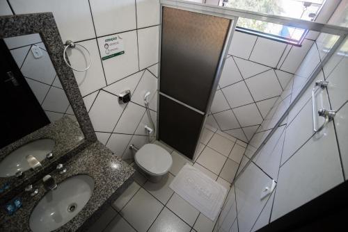 Um banheiro em Hotel Campo Verde