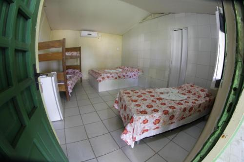 A bed or beds in a room at Pousada Cataventos