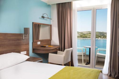 Un ou plusieurs lits dans un hébergement de l'établissement Hotel Astarea