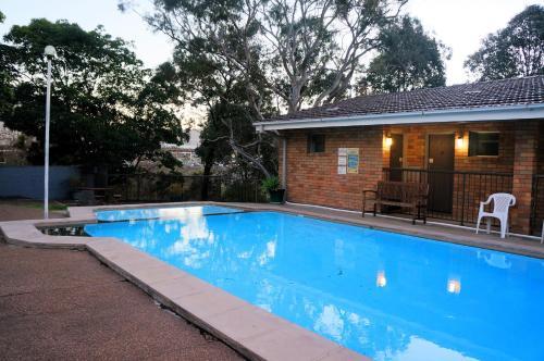 The swimming pool at or near Panorama Motor Inn