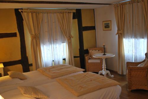 Un ou plusieurs lits dans un hébergement de l'établissement Auberge Saint Laurent