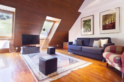 A seating area at Luderna - Apartamento Mirador Bonaigua