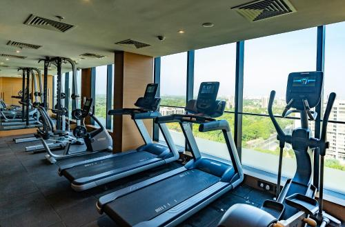 The fitness center and/or fitness facilities at DoubleTree by Hilton Ahmedabad