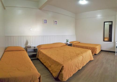 A bed or beds in a room at Bomar Residence
