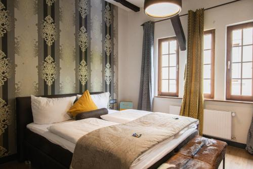Een bed of bedden in een kamer bij Boutique-Hotel Lohspeicher