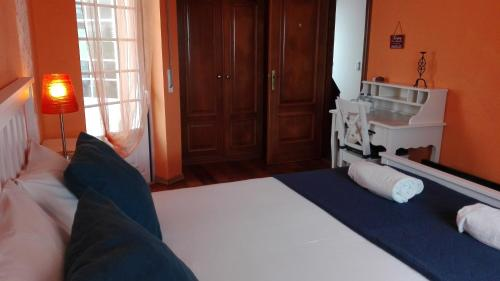 A bed or beds in a room at Casa das Conchas