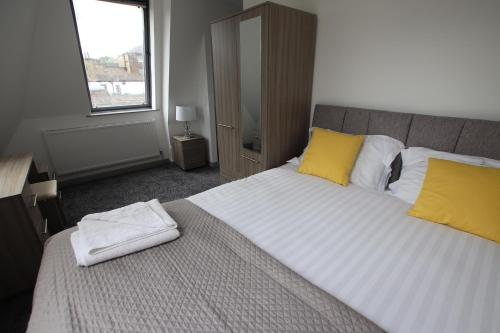 A bed or beds in a room at Halifax House, One Bedroom 203