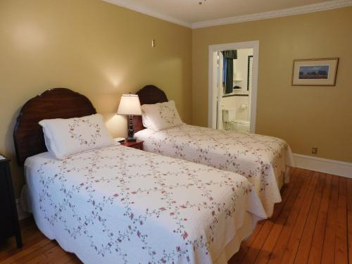 A bed or beds in a room at Celtic Charm Bed and Breakfast
