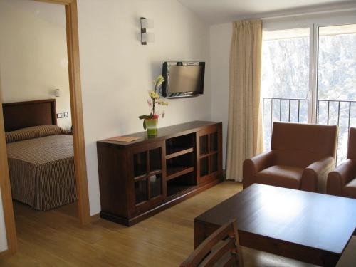 A television and/or entertainment center at Obaga Blanca & Spa